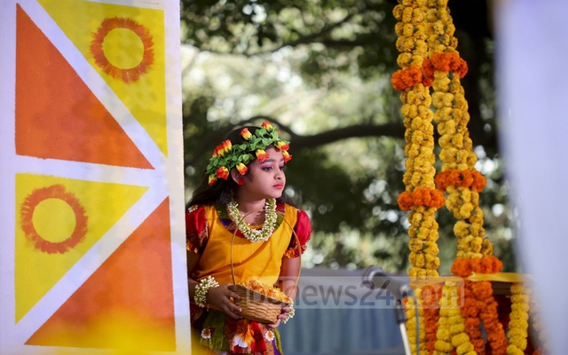A child dancer waits before entering the stage for her performance welcoming spring on Monday. Photo: asaduzzaman pramanik