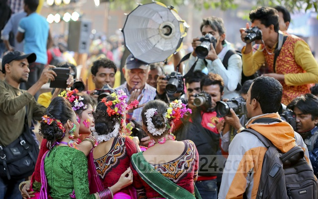 Photographers flock a group of dancers at Dhaka University's programme to welcome spring on Monday. Photo: asaduzzaman pramanik
