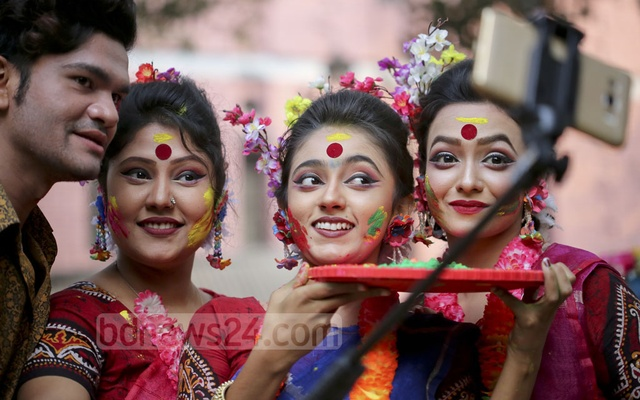 Selfies snapped to preserve that perfect moment during spring festivities at Dhaka University. Photo: asaduzzaman pramanik