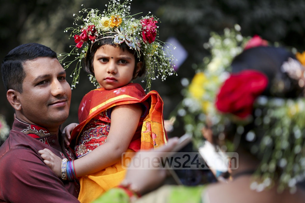 Families with young ones join the programmes welcoming spring at Dhaka University's Faculty of Fine Arts. Photo: asaduzzaman pramanik