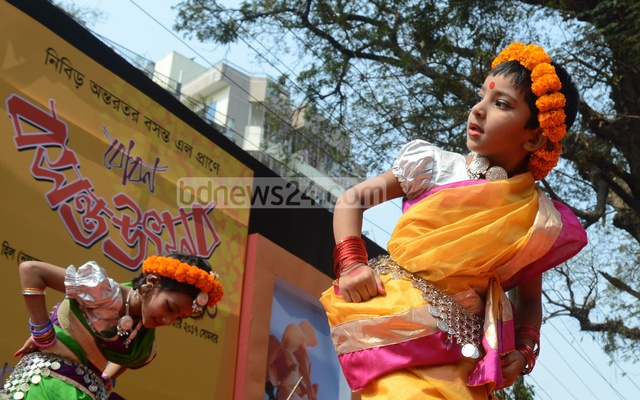 Dancers, dressed as beloved Bauls of Bengal, perform welcome spring on its first day at Chittagong's DC Hill. Photo: suman babu