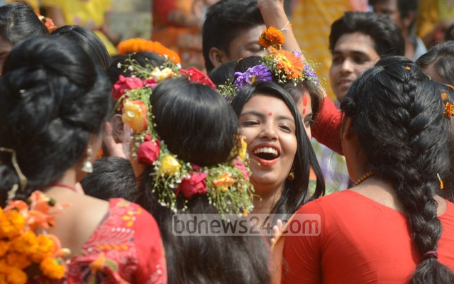 Young women in bright sarees splash colour to the programme welcoming spring on its first day at Chittagong's DC Hill. Photo: suman babu