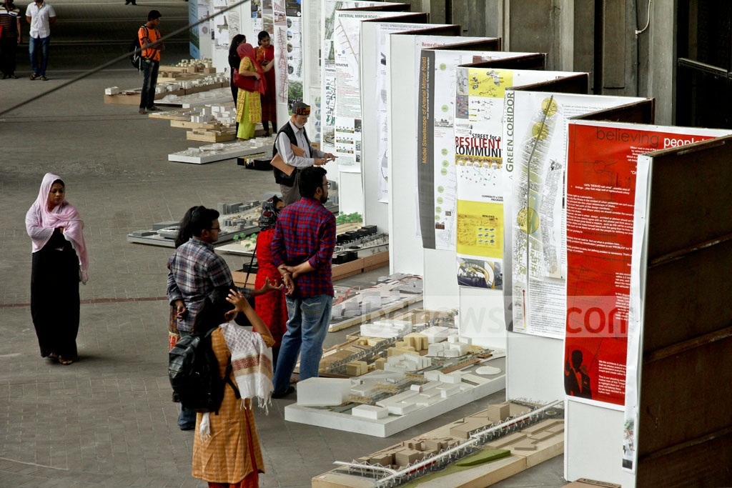 Visitors at an exhibition of designs and models, which can be used for Dhanmondi and Mirpur Road, at Nagar Bhaban on Wednesday. Dhaka South City Corporation organised the exhibition. Photo: tanvir ahammed
