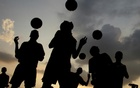 Players from a soccer academy practice against the setting sun in the northern Indian city of Chandigarh August 30, 2007. Reuters