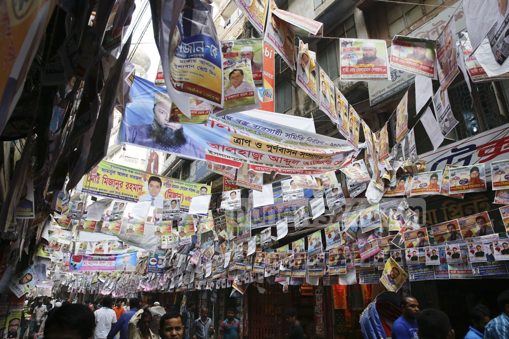 Streets and alleys are covered with fliers and posters ahead of the Islampur Textile Traders' Association elections. Photo taken on Thursday. Photo: mostafigur rahman