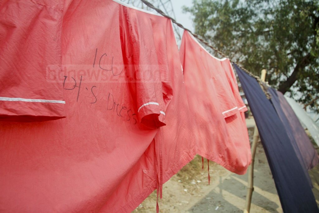 Hospital aprons hung out to dry by the Burhiganga at Kamrangirchar Berhibandh, after they have been washed in the polluted river.