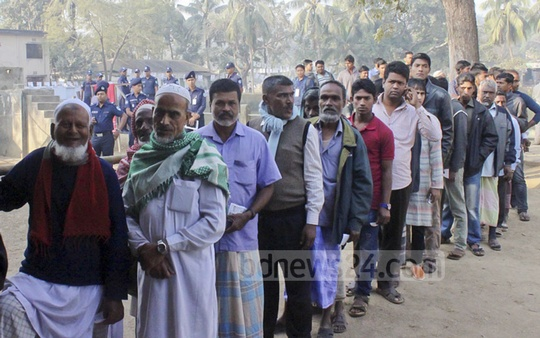 Voters queue for polls in Rangamati's Baghaicharhi on Thursday, the first election held under the new Election Commission.