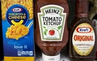 A Heinz Ketchup bottle sits between a box of Kraft macaroni and cheese and a bottle of Kraft Original Barbecue Sauce on a grocery store shelf in New York City, New York, US Mar 25, 2015.  Reuters