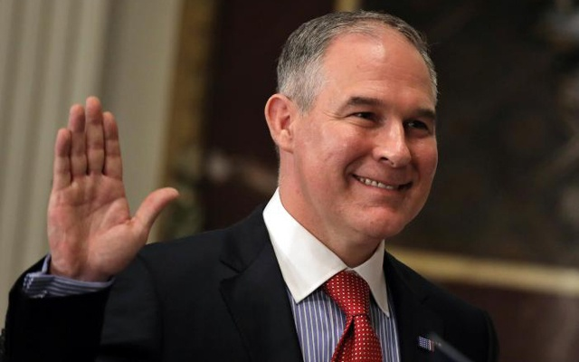 Director of Environmental Protection Agency (EPA) Scott Pruitt is sworn in by Justice Samuel Alito (not pictured) at the Executive Office in Washington, US Feb 17, 2017. Reuters