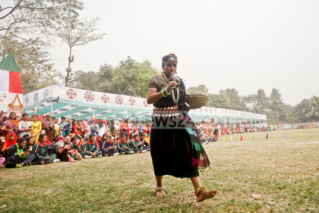 A student plays a snake charmer during a 'go as you like' competition at Eden Mohila College on Sunday.