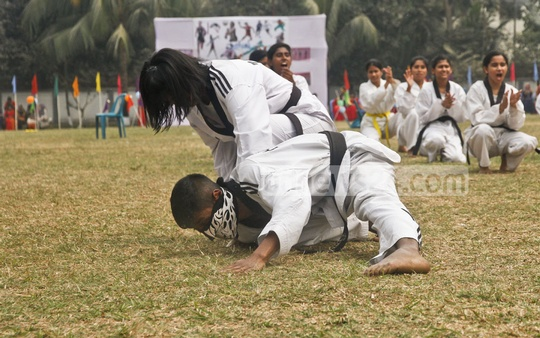 Students of Eden Mohila College display taekwondo skills at the closing ceremony of their annual sports competition on Sunday.