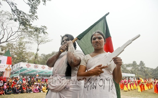 Students dress as 'Joyeeta '71' or women freedom fighters during a 'dress as you like' competition at Eden Mohila College on Sunday.