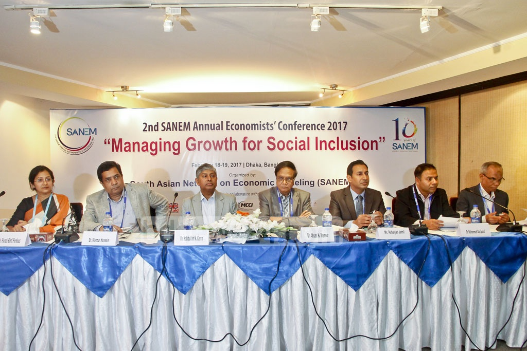 Participants discussing economic issues at the 2nd Economists' Conference organised by South Asian Network of Economic Modeling (SANEM) in the capital's BRAC Centre Inn on Sunday. Photo: tanvir ahammed