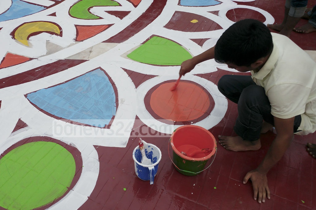 Dhaka University students painting the Shaheed Minar premises on Sunday ahead of the International Mother Language Day.