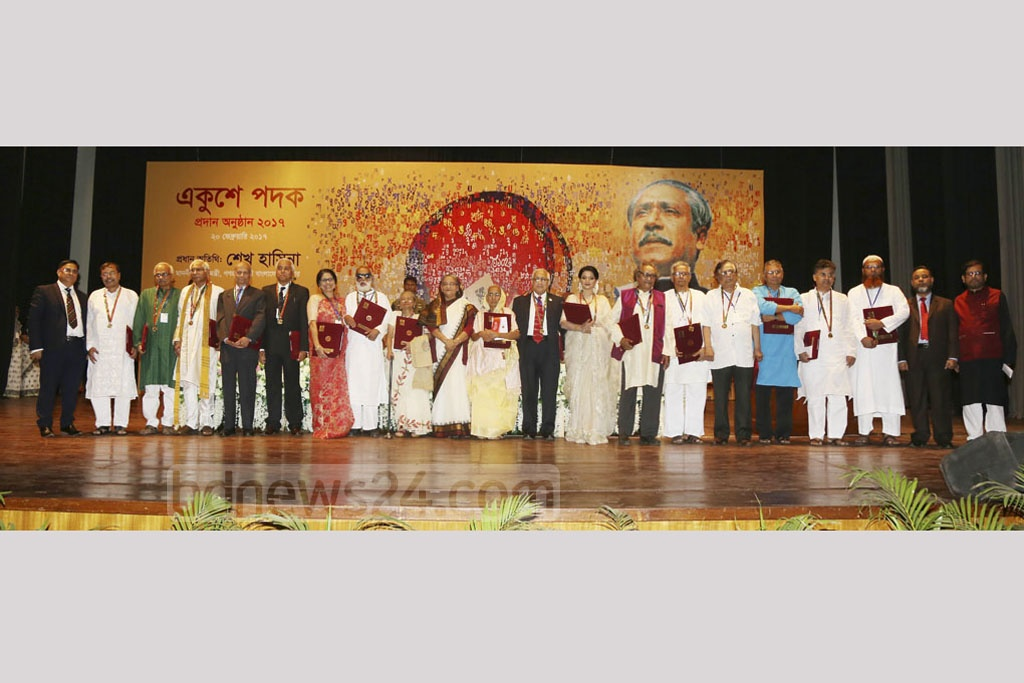 Prime Minister Sheikh Hasina poses for photographs with winners of this year's Ekushey Padak on Monday.