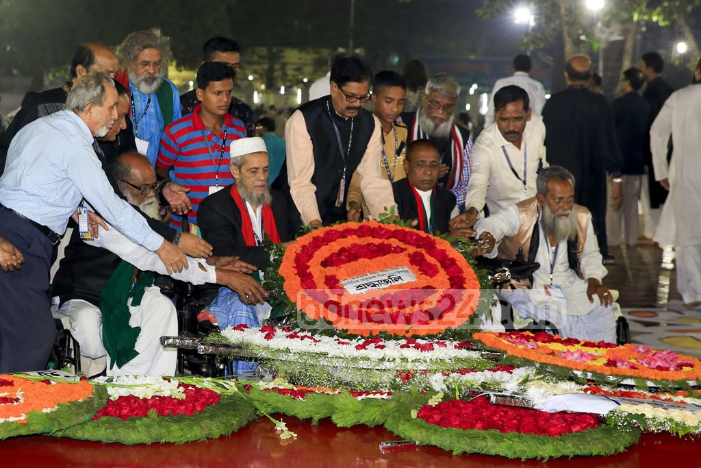 Freedom fighters in wheelchairs, injured in Bangladesh's 1971 Liberation War, pay tribute to the Language martyrs at the Central Shaheed Minar on Tuesday. Photo: mostafigur rahman