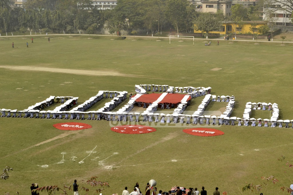 Rajshahi College students form a human Shaheed Minar during a display on the International Mother Language Day. Photo: Gulbar Ali Juwel