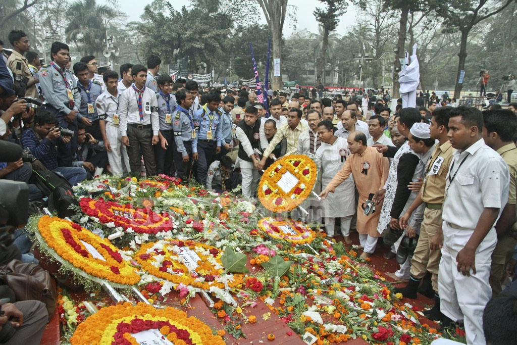 Various organisations lay wreaths of flowers to honour the Language Movement at the Central Shaheed Minar on International Mother Language Day. Photo: tanvir ahammed