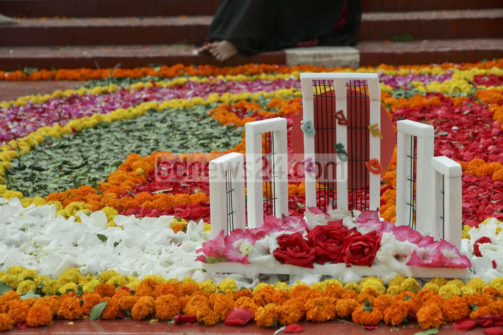 A model of the Central Shaheed Minar stands amid a flower display to commemorate International Mother Language Day on Tuesday. Photo: tanvir ahammed