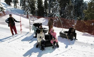 Customers and inner tube renters rest on the side of the piste at the ski resort in Malam Jabba, Pakistan Feb 7, 2017. Reuters