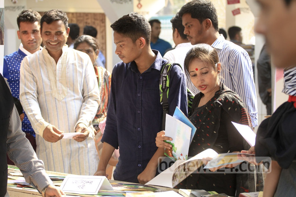 Visitors browse books at a stall of Amar Ekushey Book Fair at Suhrawardy Udyan on Tuesday. Photo: abdul mannan