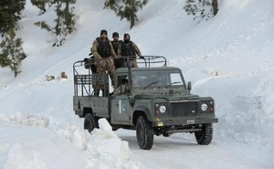 Army personnel drive up to their base beside the ski resort in Malam Jabba, Pakistan Feb 7, 2017. Reuters
