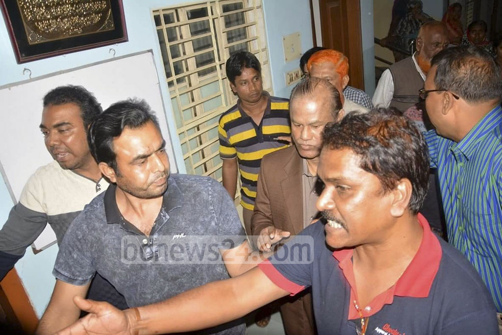 Police arrest former Jatiya Party MP of Gaibandha's Sundarganj, Abdul Kader Khan (dark brown suit), at his house in Bogra on Tuesday after putting guards around the house for six days.