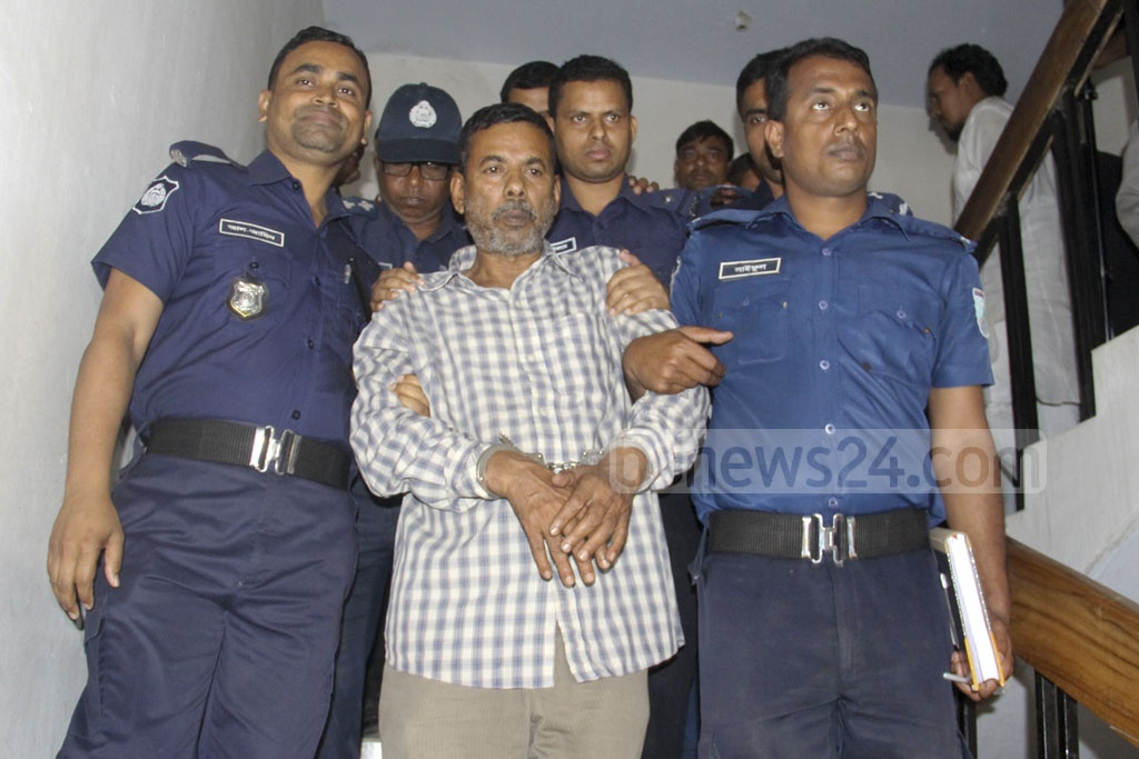 Bus driver Jamir Hossain is escorted out of a courtroom in Manikganj on Wednesday after being sentenced to life imprisonment for a crash that killed five people including filmmaker Tareque Masud and ATN News CEO Mishuk Munier in 2011.