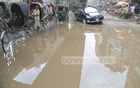 The trapped water because of the flyover construction at Mouchak intersection tests patience of the commuters.