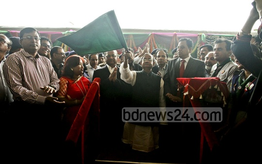 Railways Minister Mazibul Hoque waving a green flag to inaugurate new coaches of Dhaka-Sylhet train Joyontika Express on Thursday. Photo: tanvir ahammed