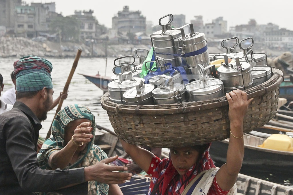 Their daily job is to carry the food for Old Dhaka businesses from their Keraniganj homes. These people have collected food from around 20 homes and will return the boxes after lunch. Photo: tanvir ahammed