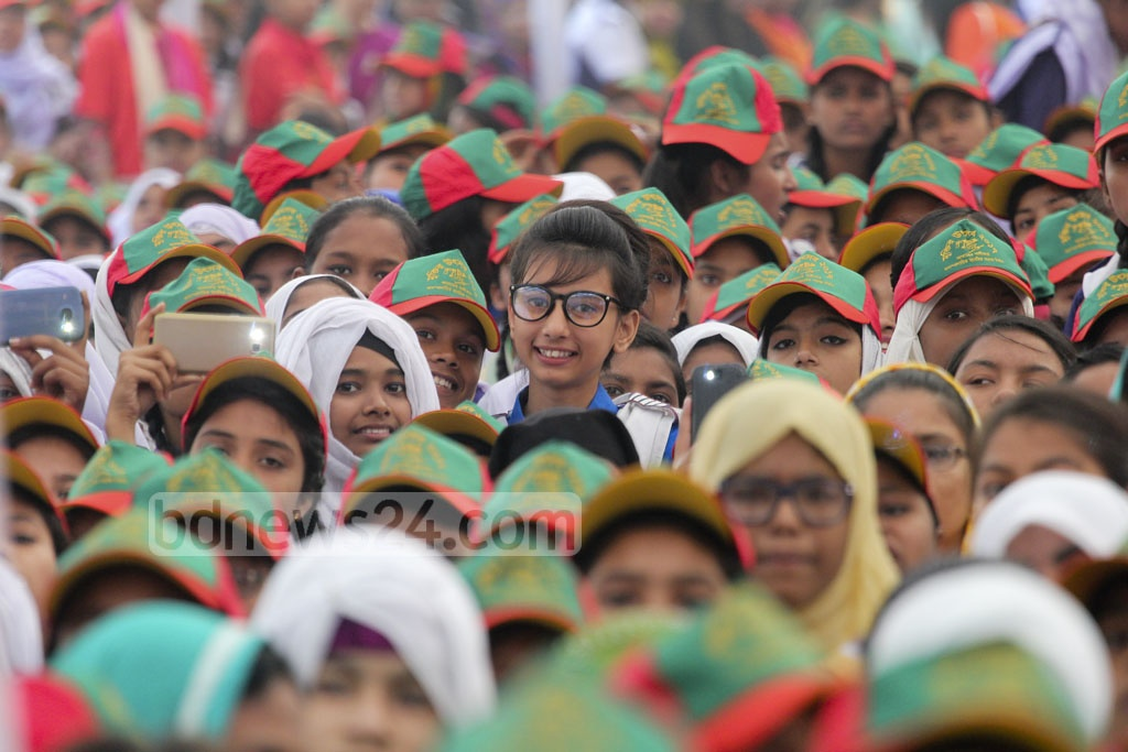 Students attend 'Muktir Utshob', a programme by the Liberation War Museum, at Dhaka University's central playground on Friday. Photo: asif mahmud ove