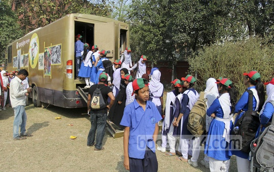 Students stand in line to see exhibits inside a van by the Liberation War Museum at Dhaka University on Friday. Photo: asif mahmud ove