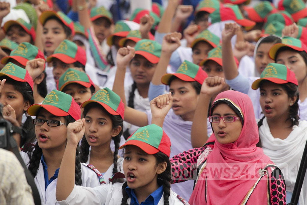 Schoolgirls take oath to uphold non-communal values during Friday's 'Muktir Utshob' at Dhaka University's central Playground. Photo: asif mahmud ove