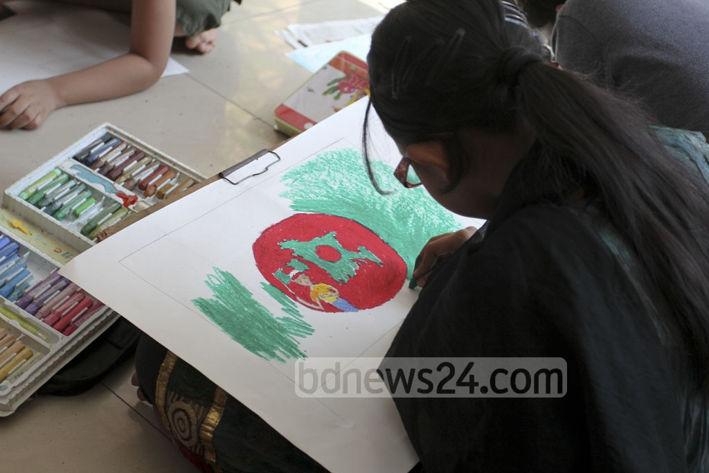 A little girl delves into her portrayal of the Bangla Language Movement during an art competition at Abul Barkat Memorial Museum on Friday. Photo: asif mahmud ove