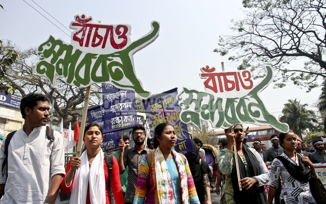 Protesters take out a procession in Dhaka against a power plant near the Sundarbans. File Photo