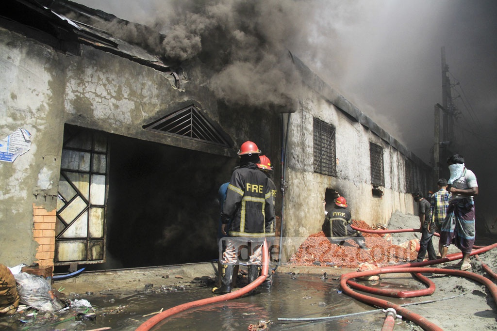 Fire crews are trying to douse the fire that broke out at a footwear factory at Jartabarhi on Monday. Photo: abdul mannan