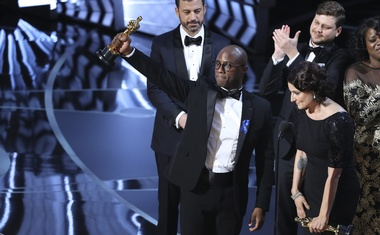 Director Barry Jenkins holds the Oscar as Moonlight wins Best Picture. Reuters
