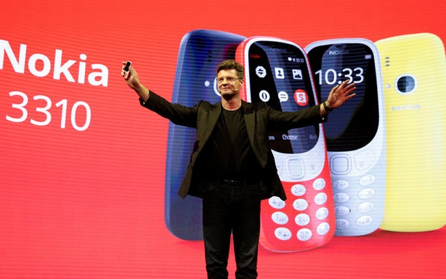 Arto Nummela, CEO of Nokia-HMD, holds up a Nokia 3310 device during a presentation ceremony at Mobile World Congress in Barcelona, Spain, February 26, 2017. Reuters