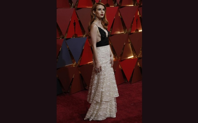 Actress Emma Roberts wears vintage Armani. Reuters