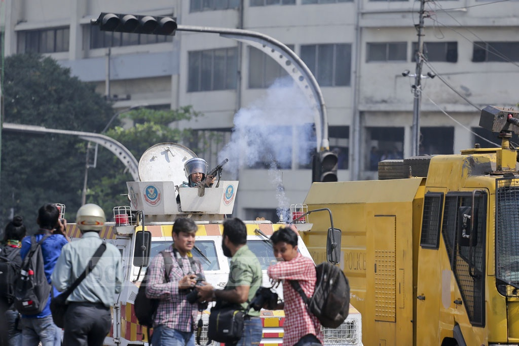 Tear gas lobbed at protesters in Dhaka by police during half-day shutdown against gas tariff hike. Photo: asaduzzaman pramanik
