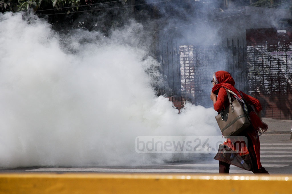 Pedestrians suffer impact of tear gas lobbed on demonstrators by police at Dhaka's Shahbagh during Left-sponsored general shutdown. Photo: tanvir ahammed