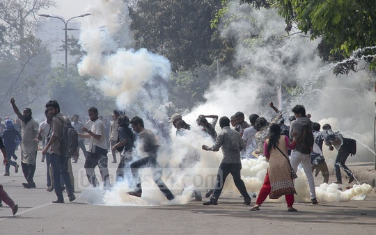 Tear gas lobbed at protesters in Dhaka by police during half-day shutdown against gas tariff hike. Photo: tanvir ahammed