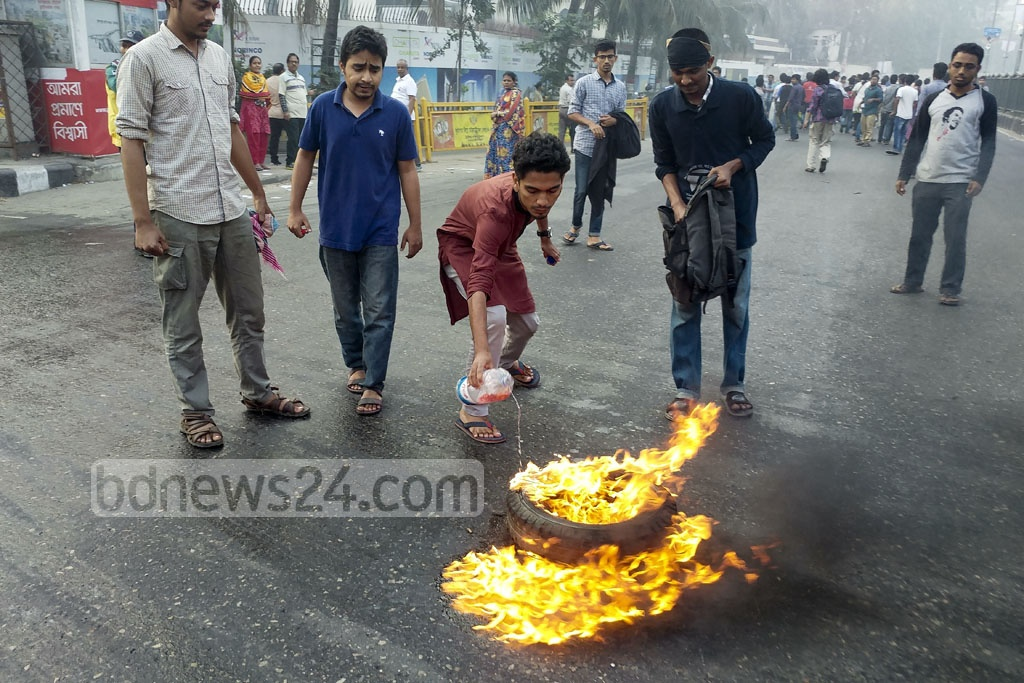Demonstrators burn tyres during a half-day general strike in Dhaka by left parties protesting gas price hike. Photo: abdul mannan