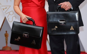 Oscar winning ballots are carried along the red carpet by Price Waterhouse Coopers personnel as they arrive for the 89th Academy Awards in Hollywood, California, US Feb 26, 2017. Reuters