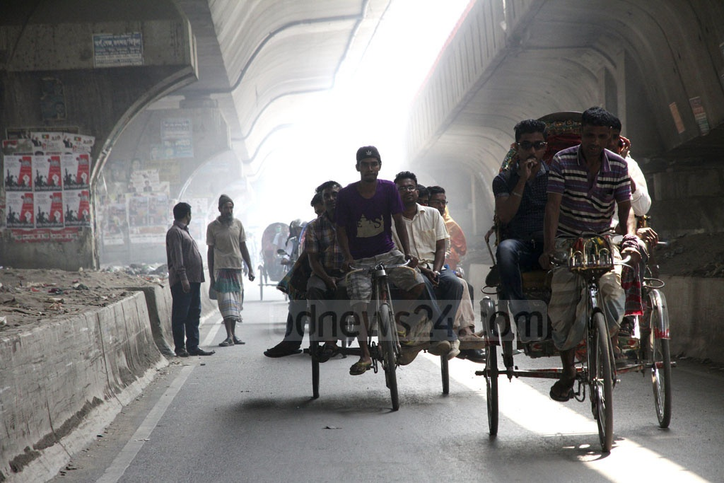 Commuters huddle together on a rickshaw van for carrying goods during a nationwide transport strike that saw transport fares reach unaffordable heights. Photo: tanvir ahammed