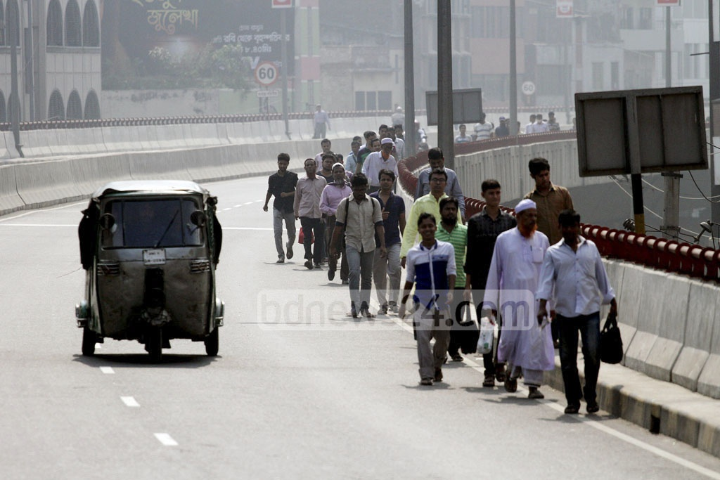 People walk to their destinations on the second day of a nationwide transport strike on Wednesday. Photo taken from Mayor Mohammad Hanif Flyover. Photo: tanvir ahammed