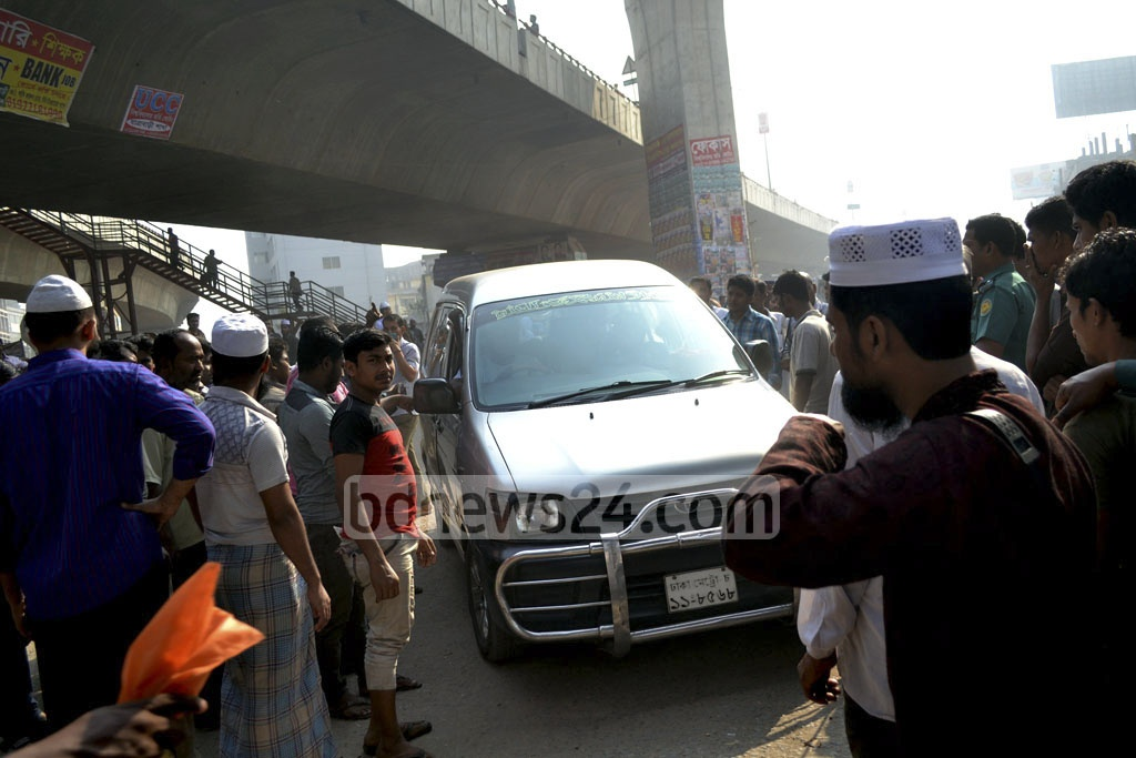 Transport workers at Sayedabad block the way for a private car during their strike. Photo: tanvir ahammed