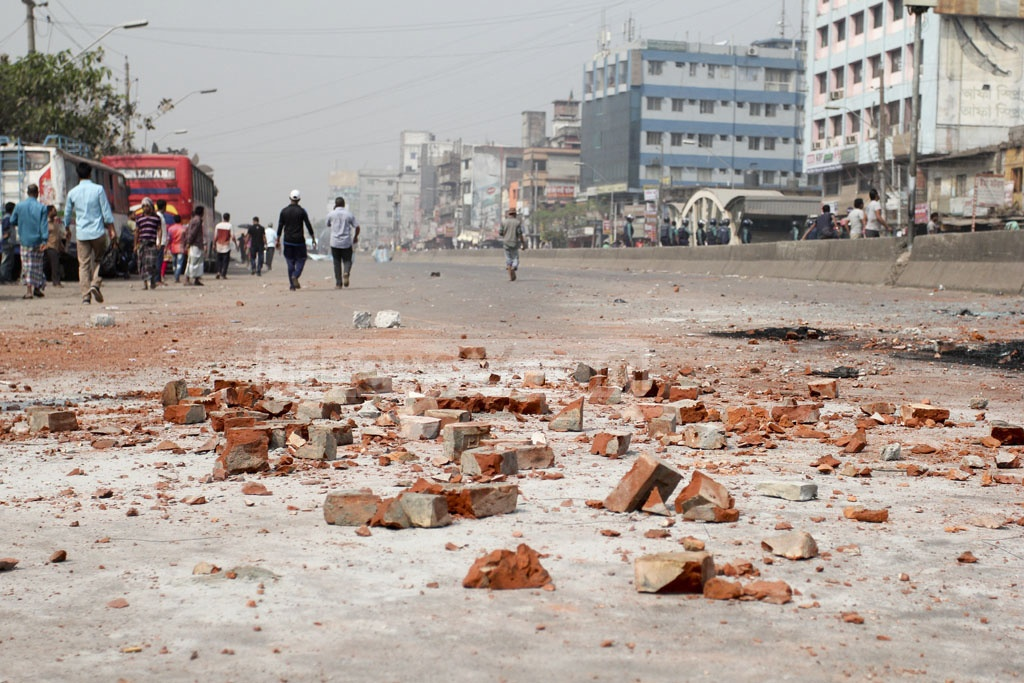 Brickbats litter a road at Gabtali after transport workers clashed with police during the second day of their strike on Wednesday. Photo: asif mahmud ove