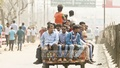 Commuters huddle together on a three-wheeler in the absence of buses during a nationwide transport strike. Photo: asif mahmud ove